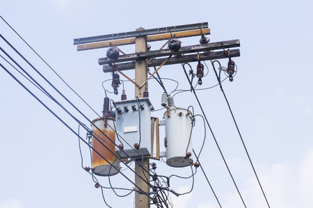 Transformer on Electricity post, high power station. High voltage with blue sky Stock Photo - 27119655
