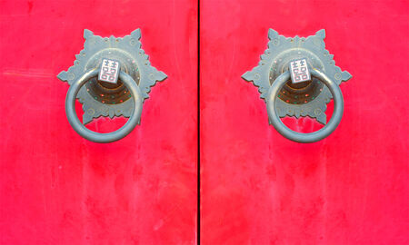 close up door knocker chinese style on red door in chinese temple Stock Photo