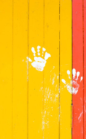 white hand paint on red yellow plank wall background