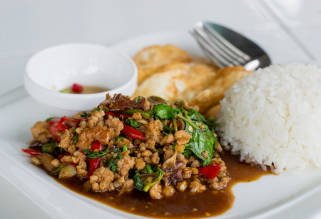 Stir-fried minced pork with holy basil and steamed rice (Thai food)