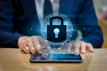Unlocked smartphone lock Internet phone hand Businesspeople press the phone to communicate in the Internet. Cyber security concept hand protection network with lock icon and virtual screens Space put message Blue tone Stock Photo