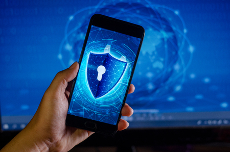 Shield Internet phone Smartphone is protected from hacker attacks, Firewall Businesspeople press the protected phone on the internet. space put message Banco de Imagens