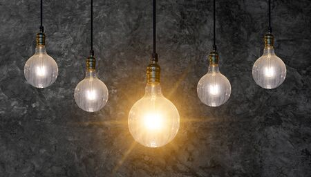 different Light bulb idea Many bulbs are arranged in a row and one of them is illuminated. Concept idea Stok Fotoğraf