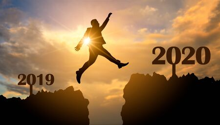 Business people are jumping across the abyss from 2019 to 2020