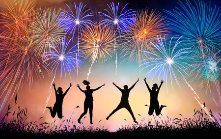 A group of teens jumping with fun and watching the fireworks
