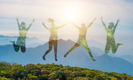 Young people are jumping with joy in the midst of the wild nature.concept Environmental day earth 版權商用圖片 - 146074827