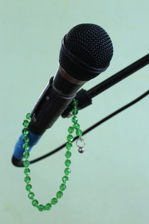 Microphone on a green background