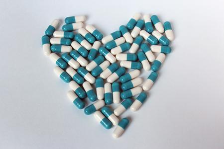 Pills heart heart on white background isolate medicine Stock Photo