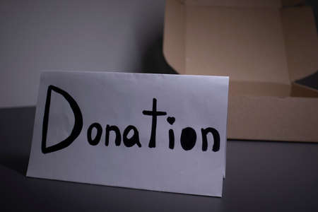 donation sign handwritten with black letters near a box. donation concept. Context of The Coronavirus Pandemic.
