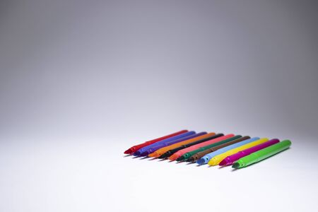 multicolored felt-tip pens on a white background. stationery concept. copy space. isolated. High quality photo