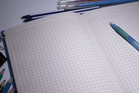 notebooks and pencils, felt-tip pens and paper clips. stationery concept. copy space. isolated