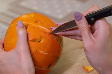 the process of making a Halloween pumpkin.