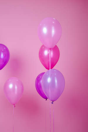 floating Colorful pink party balloons on pink pastel background. Space for text. Minimal idea creative concept of happiness, joy, birthday. holiday web banner with copy space.
