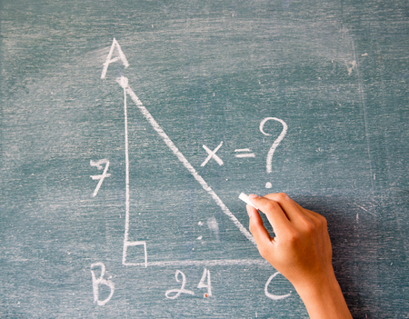 trigonometry: Maths written by white chalk on the blackboard background,greenboard