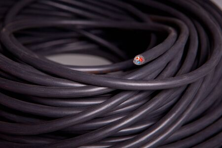 Roll of a black power cable Stock Photo