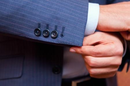 businessman correcting a sleeve