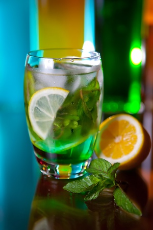 Mojito with lemon and mint garnish