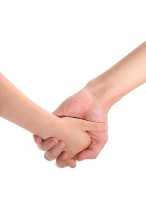 two hands holding child adult Stock Photo
