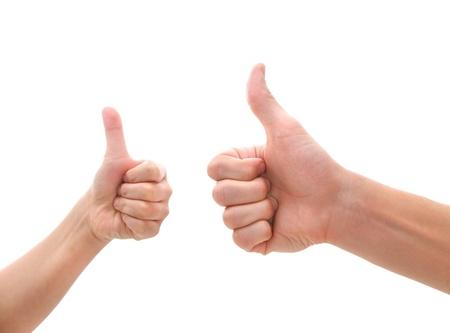 reaching hands: twee handen maken thumbs up gebaar Stockfoto