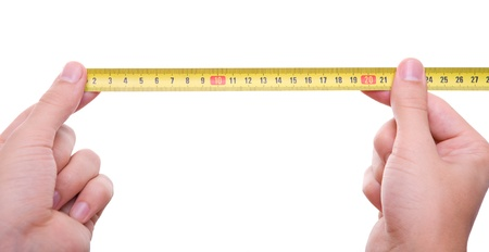 isolated hands measuring using tape measure