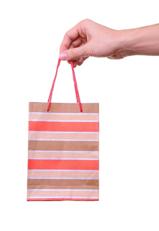 hand holding a paper shopping bag Stock Photo