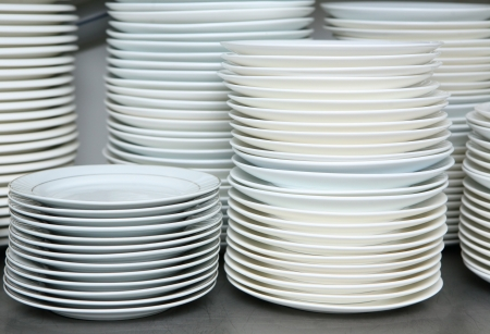 clean dishes: stack of clean dishes plates in the kitchen