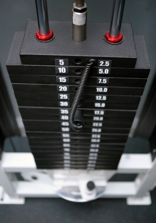 stack of black iron weights at fitness gym