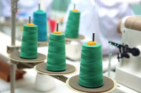 reels of green thread at tailor  Stock Photo