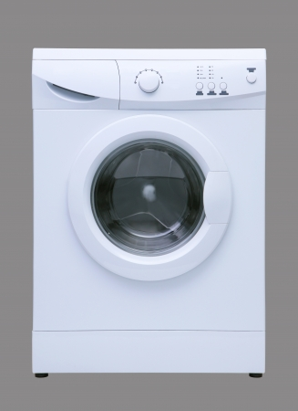 White washing machine isolated on grey photo