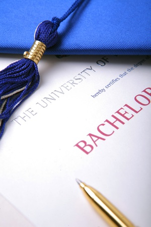 graduation cap with university diploma and pen Stock Photo