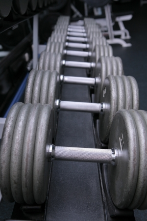 set of dumbell weights in gym Stock Photo
