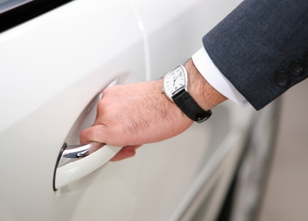 open car door: hand opening luxury car door