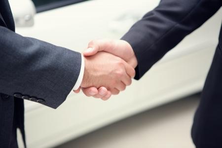 two businessman making hanshake