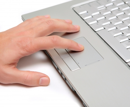 hand working on a laptop computer Stock Photo