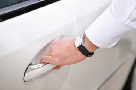 hand opening luxury car door