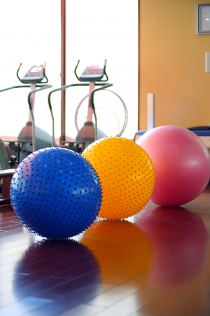 Fitness gym equipment and fitness balls Stock Photo