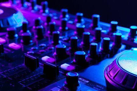 dj mixer in a night club