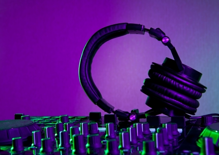 headphones and dj mixer in a night club