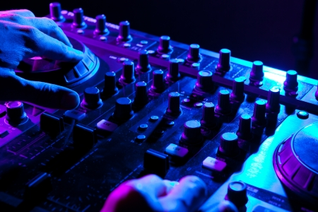dj mixing in a night club