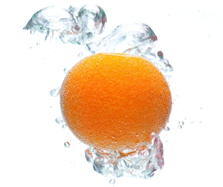 orange and bubbles floating in water