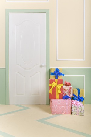 decorate: gift boxes go under the door in a bright room Stock Photo