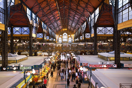 People shopping in Great Market Hall in Budapest, Hungary.