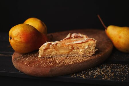 Delicious homemade pear pie on wooden background