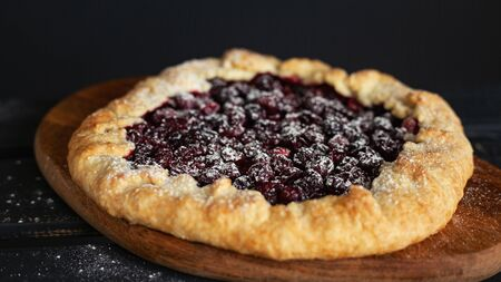 Tasty homemade galette with cherry and cranberry Standard-Bild