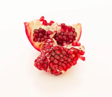 Fresh ripe pomegranate isolated on white background Standard-Bild