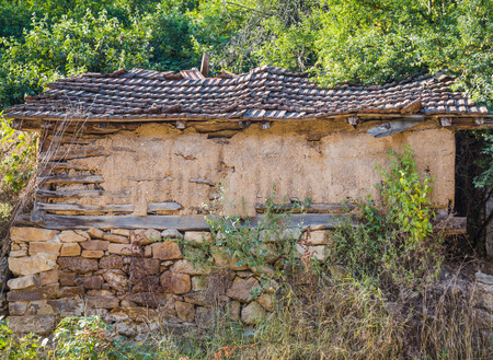 adobe wall: The old adobe house with stone foundation, HDR efect
