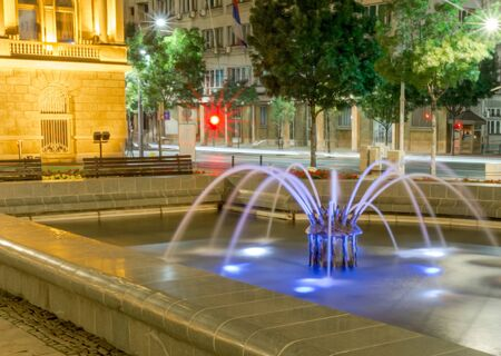 Belgrade city night scene in downtown. Long exposure photography, beautiful violet fontaine