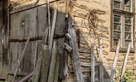 adobe wall: Old mud house, work place for carpenter Stock Photo