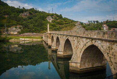 visegrad: Famous bridge in Visegrad, on river Drina, Bosnia and Herzegovina, vignette effect