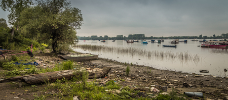 dinghies: Small fishing boats, river Danube, Belgrade Serbia, cloudy, swans and ducks Stock Photo